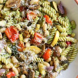 One bite of this Balsamic Roasted Veggie and White Bean Pasta and you'll want to make it all summer long! It's LOADED with veggies in every bite and finished with pesto and white beans. Roasted zucchini, yellow squash, zucchini, cherry tomatoes, red onion, mushrooms, peppers, and broccoli – SO good, and picky husband approved!