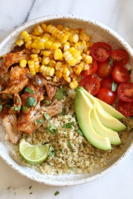 These Chipotle Chicken Bowls with Cilantro Lime Quinoa are so easy to make and have tons of flavor! I like to make them with chicken thighs but if you prefer white meat, chicken breast would work too. Extra limes for squeezing on top are recommended!