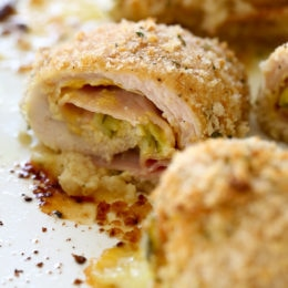 This Cubano Chicken Roll Up idea came to me after having a serious pickle craving! I wanted to make a hot dish utilizing dill pickles in some way and decided to stuff a chicken breast with everything you'd normally find in a Cuban Sandwich – pickles, mustard, Swiss, and ham. But I took it a step further and brined the cutlets overnight in pickle juice for extra flavor, the results were outstanding!!!