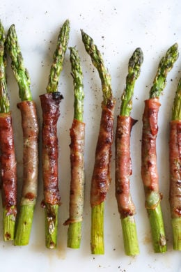 These easy Prosciutto Wrapped Asparagus can be grilled outside or indoors if you have a grill pan! Perfect as a side dish, or as an appetizer (makes a great addition to your charcuterie platter!)