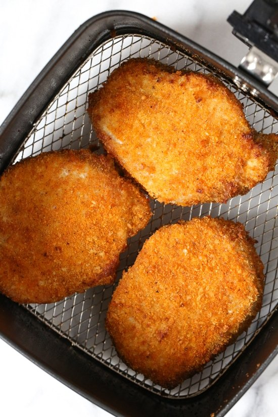 These Crispy Boneless Breaded Pork Chops come out moist on the inside and crispy on the outside! Made in the air fryer so they take just 12 minutes to cook.