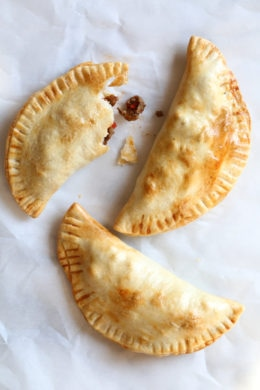 """These easy beef empanadas made with my homemade beef picadillo filling and store bought empanada dough are """"fried"""" in the air fryer for empanadas that area ready in minutes (only takes 8 minutes to cook)!"""