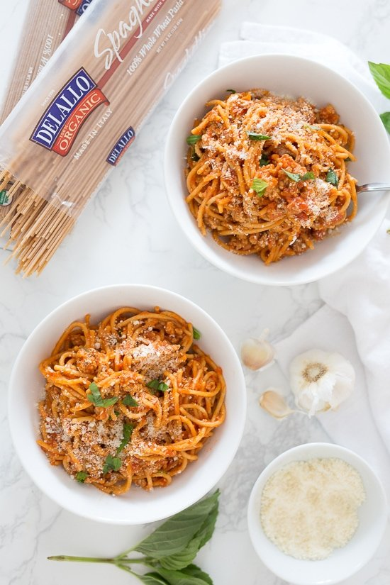 Instant Pot One-Pot Spaghetti with Meat Sauce is made with ground turkey and whole wheat pasta – hands down, the quickest and easiest way to get dinner on the table while making the whole family happy! Your solution to feeding the family on those busy weeknights and having everyone clean their plates!