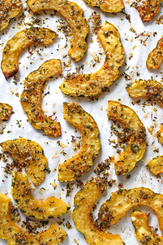 Roasted Delicata squash is delicious topped with a Parmesan-herb crust. The edges come out crisp, golden and delicious.