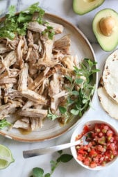 Tender shredded pork, marinated in garlic, cumin, grapefruit and lime and cooked in the pressure cooker is perfect to serve over a bed of rice or with tortillas and salsa and avocados for taco night.