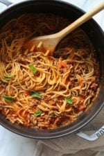This EASY Spaghetti and Meat Sauce is cooked all in one pot! The meat sauce is made from scratch on the stove and cooked with the spaghetti all at the same time. No extra pots to wash, fast and delicious!