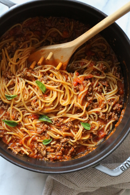 This EASY Spaghetti and Meat Sauce is cooked all in one pot! Made from scratch on the stove and cooked with the spaghetti all at the same time. No extra pots to wash, fast and delicious!
