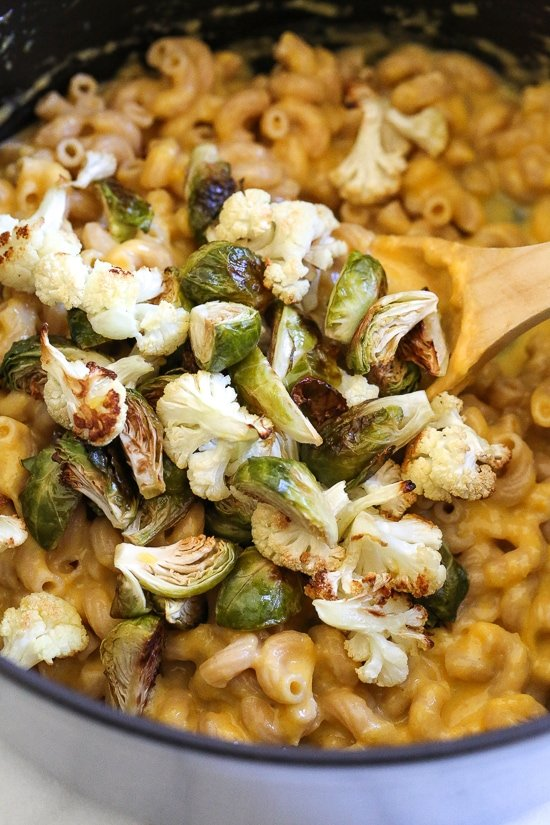 It's October, so Pumpkin Mac and Cheese with Roasted Cauliflower and Brussels Sprouts is a must for the Fall! Using pumpkin puree makes a creamy light cheese sauce, without having to add cream or too much cheese. You can make your own pumpkin puree or use organic canned pumpkin to make it faster!