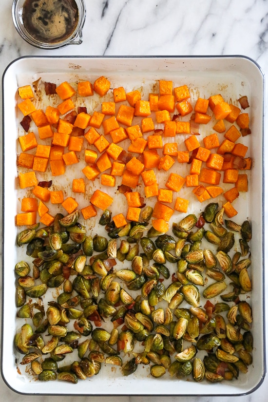 Roasted Brussels Sprouts and Butternut Squash are delicious on their own, but adding bacon and a maple soy glaze makes them over-the-top delicious! Made all on one sheet pan, you can double or triple this recipe to feed a crowd by adding more sheet pans.