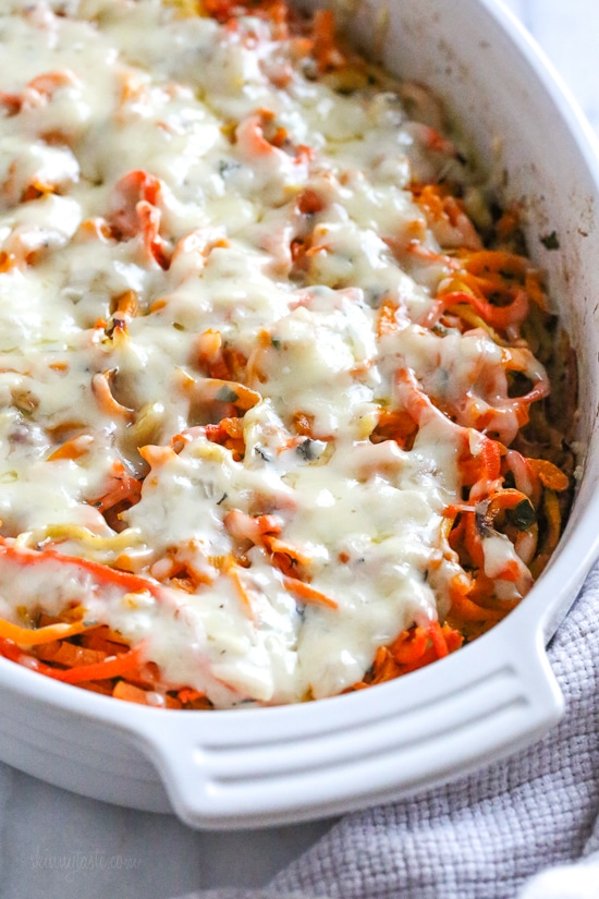 Spiralized Winter Veggie Gratin is the perfect holiday side dish! Made with spiralized vegetable gratin is made with sweet potatoes, butternut squash, carrots, and parsnips and topped with a white sauce and Gruyere cheese.