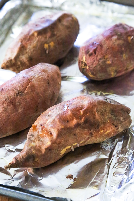 These savory stuffed sweet potatoes are topped with Italian flavors such as marinara sauce and cheese. A quick and easy healthy vegetarian dish.