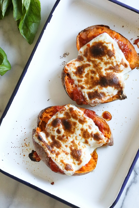 These savory stuffed sweet potatoes are topped with Italian flavors such as marinara sauce and mozzarella cheese. A quick and easy healthy vegetarian dish.