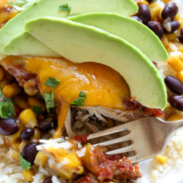 This EASY Slow Cooker Chicken dish is cheesy and delicious, made with boneless chicken breast, black beans, corn and salsa topped with melted cheddar cheese. YUM!