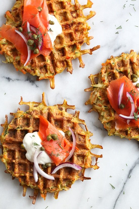 These veggie-packed latkes, are not your traditional latkes, they're made with shredded potatoes, carrots, zucchini and bell pepper, and they are cooked in a waffle iron so there's no need to fry! Top them with sour cream, lox and capers or with apple sauce on the side.