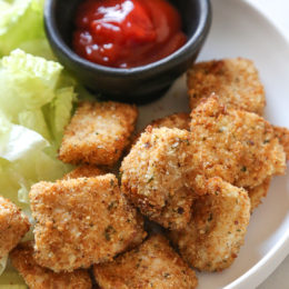 Making homemade Chicken Nuggets in the air-fryer is so much healthier than fast food or frozen nuggets, and so easy to make. Made with chunks of chicken breasts coated in breadcrumbs and parmesan cheese then air fried until golden and crisp. These also happen to be egg-free, so they are also great for kids with egg allergies.