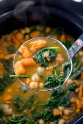 Slow Cooker Chickpea Sweet Potato Stew with warm flavors from cumin, coriander and cinnamon is the perfect winter stew you'll eat all season long.