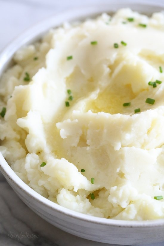 These creamy Mashed Potatoes come out perfect in the Instant Pot, and are made in a fraction of the time it takes to make on the stove!