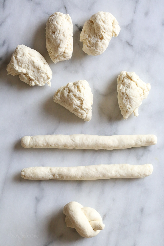These soft, garlicky knots taste just like your favorite pizzeria's garlic knots, but made from scratch using my easy yeast-free bagel dough recipe (just flour, Greek yogurt, baking powder and salt).