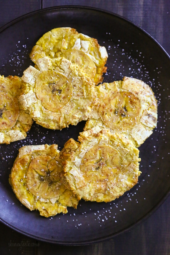 These easy tostones also known as patacones or fried green plantains are made healthier in the air fryer. No deep frying, just a few spritzes of olive oil for a crispy, delicious appetizer or side dish.