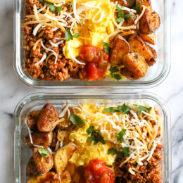 Breakfast lovers, jazz up your mornings with this Meal Prep Breakfast Taco Scramble, made with potatoes, turkey taco meat, scrambled eggs and salsa (cheese is optional!) perfect to make ahead for breakfast for the week!