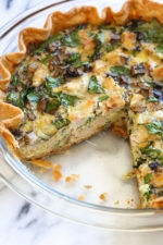 This easy lighter chicken quiche is made with refrigerated pie crust and loaded with spinach and mushrooms but you can use any combination of vegetables. A great recipe to clean out the refrigerator!