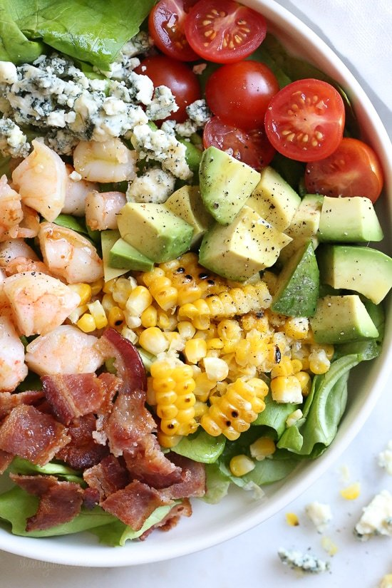This hearty Chopped Salad with Shrimp, Avocado, Blue Cheese and Bacon is simple and satisfying. Great for lunch or dinner!