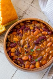 Instant Pot Baked Beans in bowl with cornbread