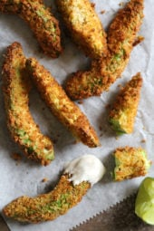 Crispy baked avocado fries coated with panko breadcrumbs with a lime dipping sauce. So fast and easy to make in the oven or air fryer!