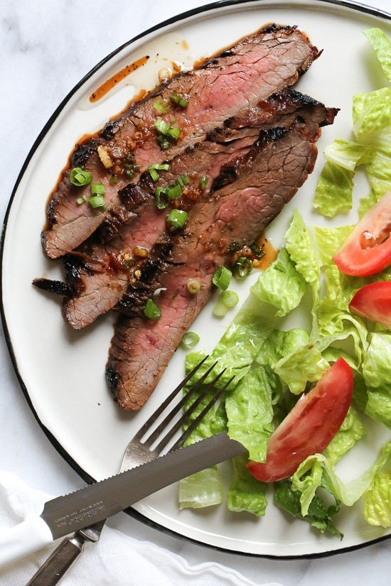 The marinade in this Grilled Asian-style Soy Marinated Flank Steak takes an uninteresting piece of steak and turns it into a mouthwatering dish!