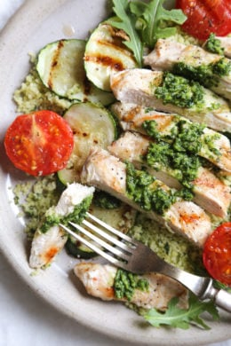 Grilled chicken, zucchini and tomatoes topped with a light spinach-arugula basil pesto served over couscous.