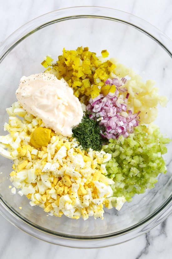 "A low-carb faux ""potato"" salad made with cauliflower instead of potatoes, perfect for Keto or if you're just looking to eat less carbs."