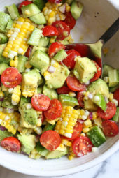 This Corn Tomato Avocado Salad is summer in a bowl! The perfect side dish with anything you're grilling, or double the portion as a main dish.