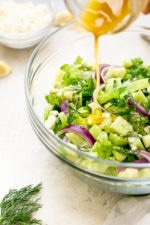 Chopped salad with romaine lettuce, Feta cheese, cucumbers, red onion and dill tossed with a simple red wine vinaigrette. An easy side salad to go with all your Mediterranean dishes.