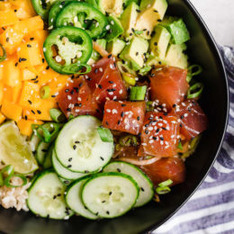 With marinated tuna, brown rice, avocado, cucumber, mango, macadamias and scallions, this Hawaiian style quick Ahi Poke Bowl is perfect for hot summer nights.