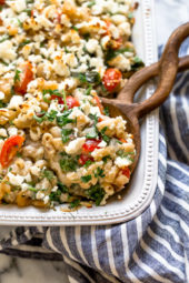 Greek Mac and Cheese, a healthy twist on a comfort food classic made in a creamy cheese sauce with whole wheat pasta, tomatoes, spinach, olives and Feta cheese.