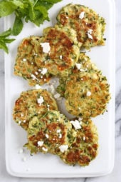 Zucchini and Feta Fritters, a fabulous summer side dish to make great use of in-season zucchini and mint.