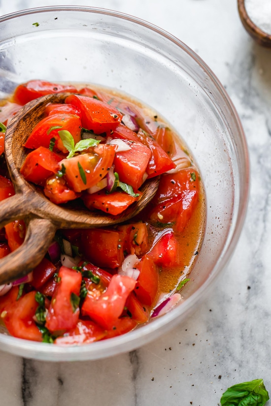 Ripe, end-of-summer garden tomatoes make the best, juiciest tomato salad, perfect served with a rustic loaf of bread!
