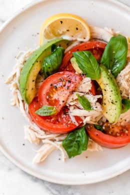 This quick and easy chicken salad is made with the breast meat of a Rotisserie chicken, avocados, fresh tomatoes, basil and lemon juice.