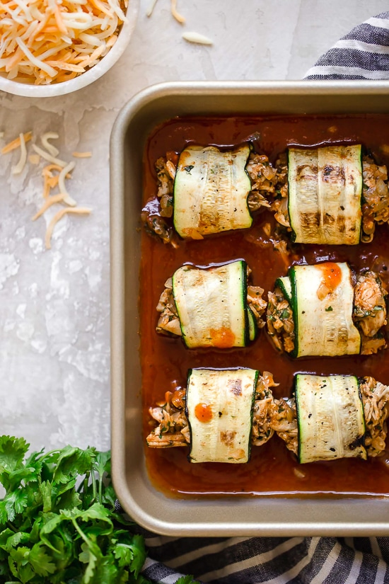 These Zucchini Chicken Enchilada Roll Ups are filled seasoned shredded chicken, topped with enchilada sauce and cheese. Delicious, and perfect for Keto, gluten-free or low-carb diets.