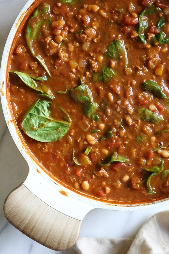 Turkey Pumpkin Chili is the perfect Fall dish made with ground turkey, tomatoes, canned pumpkin, white beans and spinach.