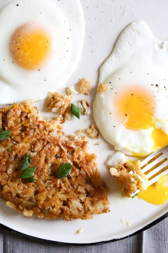 These crisp, perfectly cooked homemade hash browns are made in a skillet, with shredded potatoes, scallions and seasoning for the perfect breakfast side dish to go with your morning eggs.