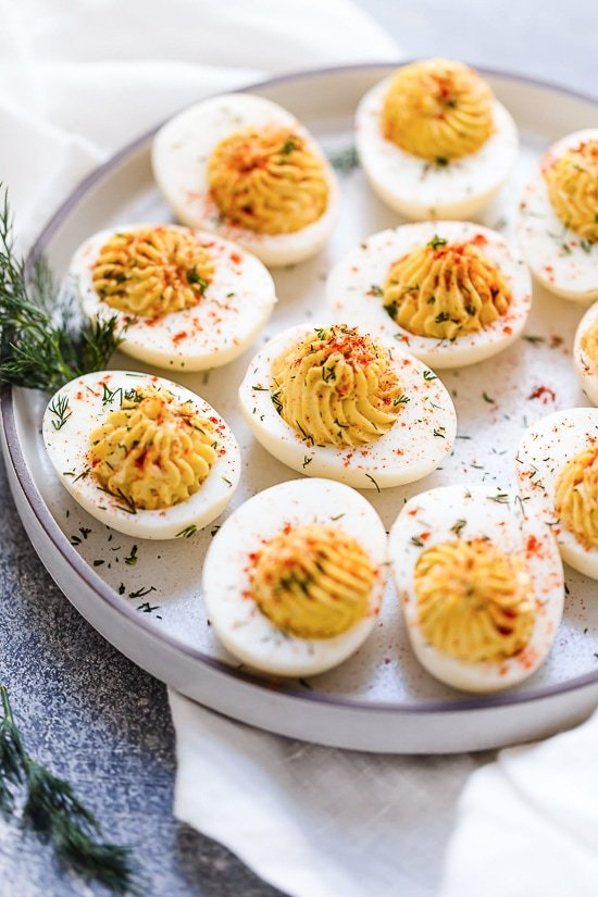 Classic deviled eggs, perfect for Easter, holidays and summer backyard gatherings! This easy and delicious deviled egg recipe is a must!