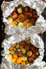 An easy Fall foil packet dinner made with spicy chicken Andouille sausage, Brussels sprouts and butternut squash. It's the perfect balance of spicy, smokey and sweet in every bite!