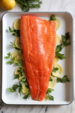 This simple Baked Salmon dish is made with fresh lemon, and lots of fresh herbs such as dill, parsley, chives.