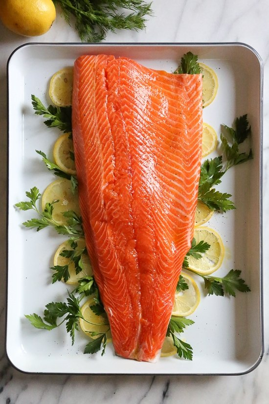 This simple, healthy Baked Salmon dish is made with fresh lemon, and lots of fresh herbs such as dill, parsley, chives.