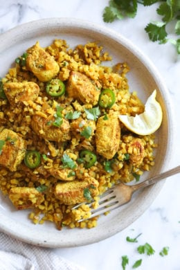 This quick and easy Indian-inspired skillet dish, is a low-carb take on Chicken Biryani, made with riced cauliflower in place of rice. It's also Keto, gluten-free and Whole30 compliant.