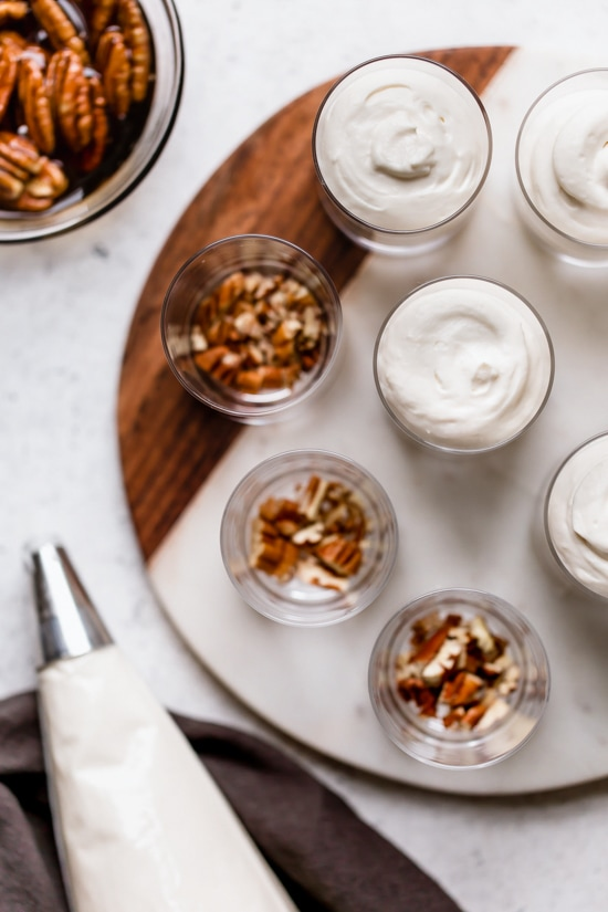 Sticking with my philosophy of eating smaller portions, I love to make desserts in shot glasses like these Maple Pecan Cheesecake Shooters!
