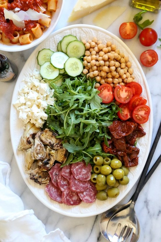 For fuss free entertaining, nothing is easier (or prettier) than creating an antipasto salad platter where everyone can help themselves.