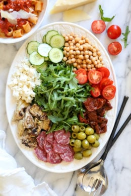 For fuss free entertaining, nothing is easier (and prettier) than creating an antipasto salad platter!