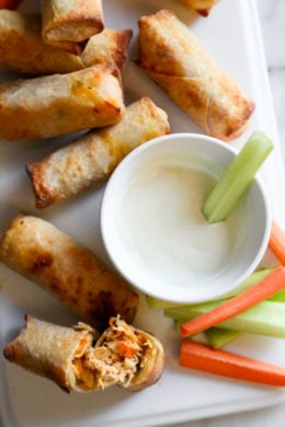 These Buffalo Chicken Egg Rolls, filled with shredded boneless chicken breast, carrots, scallions, hot sauce and blue cheese make the perfect appetizer! Bake them in the oven or air fryer!